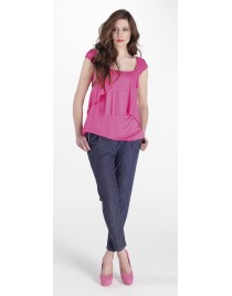 Sleeveless top with pleats and levels